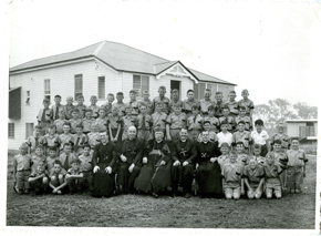 First class of Iona gather for photo in 1958